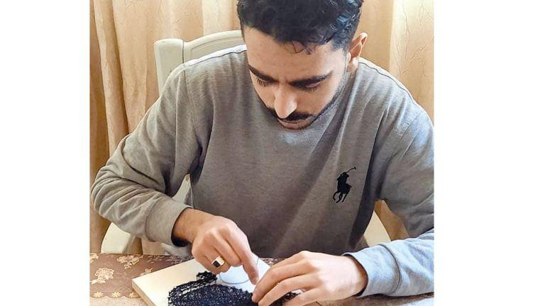 Photo of فلسطيني يتخصص في الرسم بالخيط والمسمار